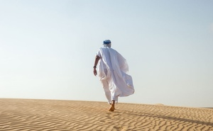 Mohamedou Ould Slahi, who underwent brutal interrogations while he was held at Guantánamo Bay 15 years ago, on a dune in Nouakchott, Mauritania, Aug 17, 2021. The New York Times