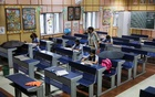 Girls study inside a classroom following the reopening of schools at 50% capacity for the students of classes 9 to 12 after months of closure due to the coronavirus disease (COVID-19) outbreak, at a government school in New Delhi, India, Sept 1, 2021. REUTERS/Anushree Fadnavis
