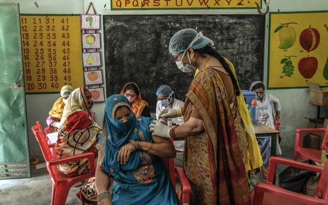A woman winces as she receives a COVID-19 vaccination in Mohammadpur Kadeen, a village in the state of Utter Pradesh, India, on June 4, 2021. The New York Times