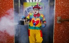 Shaharul Hisam bin Baharuddin, 43, dressed as a clown, disinfects a lift inside a shopping mall in Taiping, Malaysia September 10, 2021. REUTERS