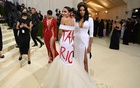 Rep. Alexandria Ocasio-Cortez (D-N.Y.), centre, at the Metropolitan Museum of Art's Costume Institute benefit gala in New York, Sept. 13, 2021. (Nina Westervelt/The New York Times)