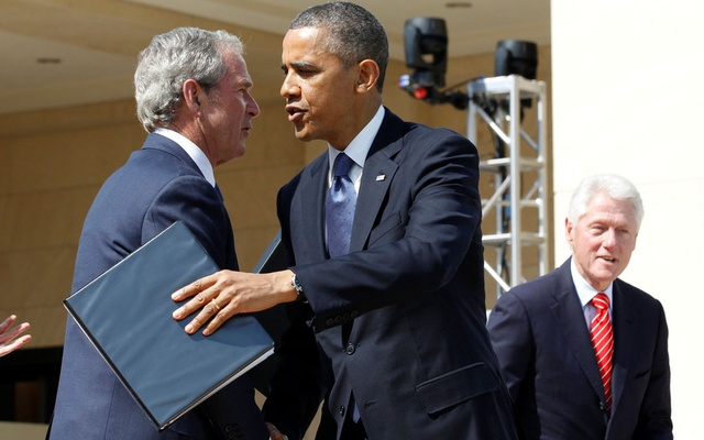 US President Barack Obama embraces former President George W Bush following remarks at the dedication ceremony of the George W Bush Presidential Centre in Dallas, April 25, 2013. Former president Bill Clinton is pictured at right. REUTERS