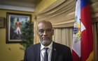 FILE — Haiti's acting prime minister, Ariel Henry, at his residence in Port-au-Prince on Aug 3, 2021. Haiti's chief prosecutor on Tuesday, Sept 14, 2021, ordered Henry not to leave the country until he answers questions about the July assassination of President Jovenel Moïse. (Victor Moriyama/The New York Times).