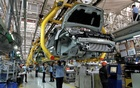 Workers assemble Ford cars at a plant of Ford India in Chengalpattu on the outskirts of Chennai, India March 5, 2012. REUTERS