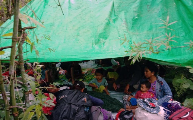 In a handout photo, Yay Shin villagers hiding in the jungle after fleeing an attack by Myanmar soldiers in the northwestern region of Kalay, Sept. 6, 2021. The army has escalated attacks on militias that oppose its rule, driving thousands of people into the hills. A shadow government has called for a nationwide uprising. (Via The New York Times)