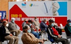 People wait in a COVID-19 vaccination centre, as Portugal resumes vaccination with AstraZeneca shots after a temporary suspension, amid the coronavirus disease (COVID-19) pandemic, in Seixal, Portugal, March 22, 2021. Reuters