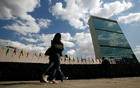 Tourists walk past the United Nations Headquarters in New York, March 24, 2008. At left is the UN General Assembly building and at right is the UN Secretariat building. REUTERS