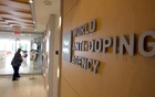 A woman walks into the head office of the World Anti-Doping Agency (WADA) in Montreal, Quebec, Canada November 9, 2015. REUTERS