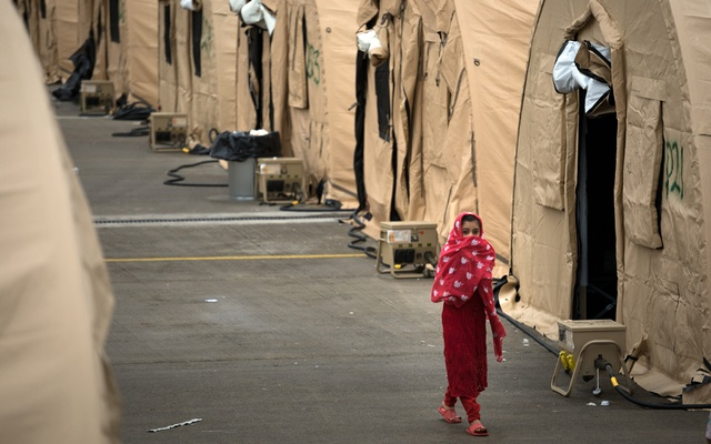 Temporary living facilities for Afghan evacuees at Ramstein Air Base in Germany on Aug. 30, 2021. Tens of thousands of Afghans hoping to be resettled in the United States remain on bases. (Gordon Welters/The New York Times