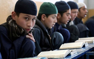 Afghan boys read the Koran in a madrasa, or religious school, during the Muslim holy month of Ramadan in Kabul, Afghanistan April 18, 2021. REUTERS/Omar Sobhani