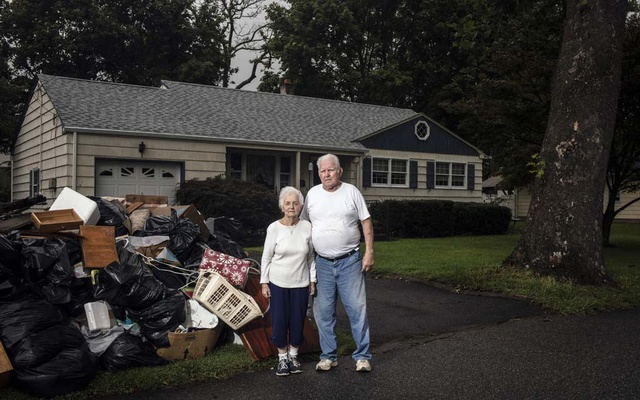 George and Joan Babish outside their flood-damaged home in South Plainfield, NJ, on Sept 9, 2021. The remnants of Hurricane Ida filled their basement with four feet of water, ruing a newly-purchased furnace. Bryan Anselm/The New York Times
