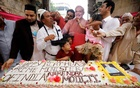 People cut a 71-kilogram cake to celebrate Indian Prime Minister Narendra Modi's 71st birthday at an event in Ahmedabad, India, Sept 17, 2021. REUTERS/Amit Dave