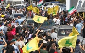 People hold Hezbollah and Iranian flags near cars as a convoy of tanker trucks carrying Iranian fuel oil drive in Baalbeck, Lebanon September 16, 2021. REUTERS