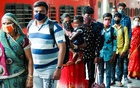 Commuters wait in a queue to have their temperature checked amidst the spread of the coronavirus disease (COVID-19) at a railway station in Mumbai, India, Aug 27, 2021. REUTERS/Francis Mascarenhas