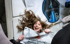 In an image provided by SpaceX, Hayley Arceneaux, Inspiration4's medical officer, a cancer survivor and the first person in space with a major prosthetic. The Inspiration4 mission, which launched on Wednesday, Sept 15, 2021, shows how medical researchers can benefit from the new commercial space travel. (John Kraus/Inspiration4 via The New York Times)