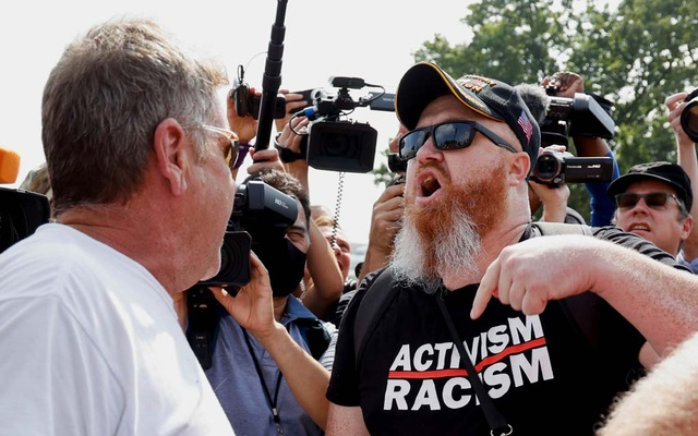 Counter-protester Russell Tee confronts a demonstrator during a rally in support of defendants being prosecuted in the January 6 attack on the US Capitol, in Washington, DC, US, September 18, 2021. Reuters