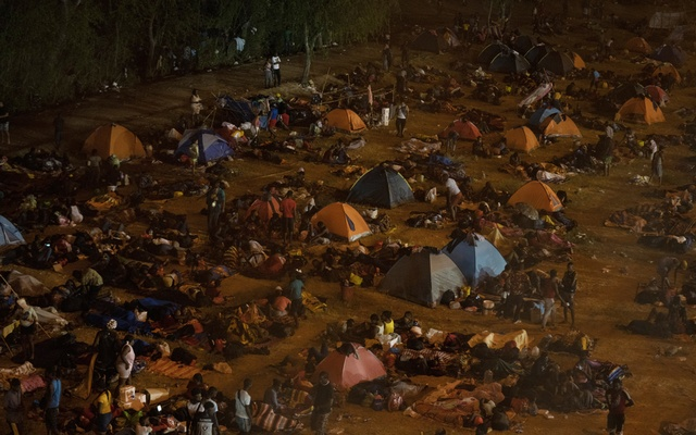 People seeking asylum camp near the international bridge in Del Rio, Texas on Thursday, Sept 16, 2021. The temporary camp in Del Rio has grown with staggering speed in recent days during a massive surge in migration that has overwhelmed the authorities. Verónica G Cárdenas/The New York Times