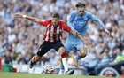 Football - Premier League - Manchester City v Southampton - Etihad Stadium, Manchester, Britain - September 18, 2021 Manchester City's Jack Grealish in action with Southampton's Jan Bednarek REUTERS/Phil Noble