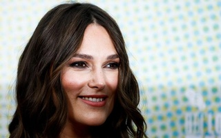 Actor Keira Knightley looks on as she attends the European premiere of