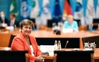 Managing Director of the International Monetary Fund (IMF) Kristalina Georgieva poses for a photo in front of German Chancellor Angela Merkel during a meeting with directors of the ILO, IMF, OECD, World Bank and more to discuss questions on the current state of the global economic situation, in Berlin, Germany, Aug 26, 2021. Clemens Bilan/REUTERS