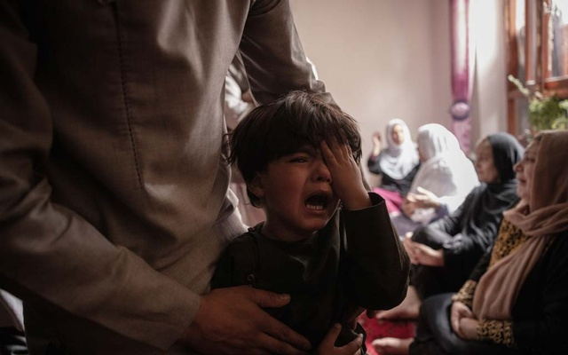 A boy cries in Kabul, Afghanistan on Aug. 30, 2021, after his sister was killed in a US drone strike a day earlier. The Pentagon acknowledged on Friday, Sept. 17, 2021, that a US drone strike in Afghanistan on Aug. 29 that officials said was necessary to prevent an attack on American troops was a tragic mistake that killed 10 civilians, including seven children, an American military official familiar with the investigation said. (Jim Huylebroek/The New York Times)