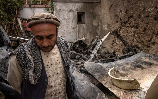 A relative of Zemari Ahmadi near remnants of a vehicle destroyed by a US drone strike that occurred a day earlier, in Kabul, Afghanistan on Monday, Aug 30, 2021. Jim Huylebroek/The New York Times