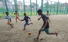 A playground in Old Dhaka was inaugurated after the renovation work, but it has not yet been opened to the children. Unable to enter the barricaded playground, youths play football in an empty space outside. Photo: Asif Mahmud Ove