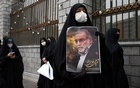 A protester holds an image of the Iranian nuclear scientist Mohsen Fakhrizadeh during a demonstration outside Parliament in Tehran on Saturday, Nov 28, 2020, a day after Fakhrizadeh was killed. Arash Khamooshi/The New York Times