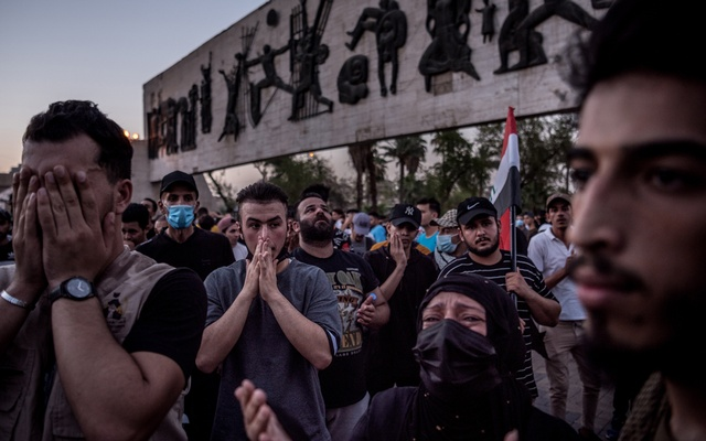 Protesters pray for their fallen friends at a rally in Baghdad, Iraq, on July 18, 2021. Militia violence has driven antigovernment protesters underground and shaken Karbala, a city of gold-domed Shiite shrines. Sergey Ponomarev/The New York Times