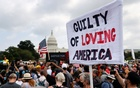 A sign is held during a rally in support of defendants being prosecuted in the January 6 attack on the US Capitol, in Washington, DC, US, September 18, 2021. REUTERS