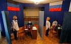 Local residents vote in the Russian parliamentary election via an online system in the rebel-held city of Donetsk, Ukraine, September 19, 2021. REUTERS/Alexander Ermochenko