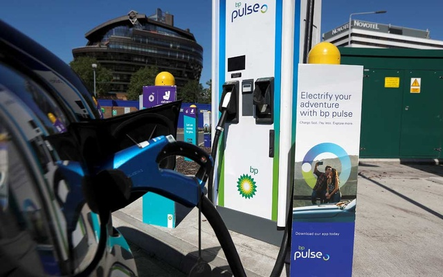 An electric powered taxi is seen being charged at a BP Pulse electric vehicle charging point in London, Britain, July 16, 2021. Reuters