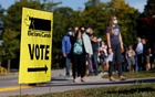 People line up outside a polling station to vote in the federal election in Bowmanville, Ontario, Canada Sept 20, 2021. REUTERS/Blair Gable