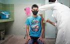 A 14-year-old boy gets a dose of the Soberana 02 vaccine during its clinical trials at a hospital amid concerns about the spread of the coronavirus disease (COVID-19) in Havana, Cuba, Jun 29, 2021. REUTERS/Alexandre Meneghini