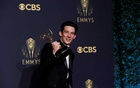 Actor Josh O'Connor poses for a picture with the award for outstanding lead actor in a drama series, for