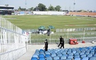 Members of the Police Elite Force walk in an enclosure at the Rawalpindi Cricket Stadium after the New Zealand cricket team pulled out of a Pakistan cricket tour over security concerns, in Rawalpindi, Pakistan September 17, 2021. REUTERS/Waseem Khan