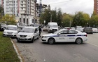 Police block the road near the scene after a gunman opened fire at the Perm State University in Perm, Russia Sept 20, 2021, in this still image taken from video. REUTERS/Anna Vikhareva