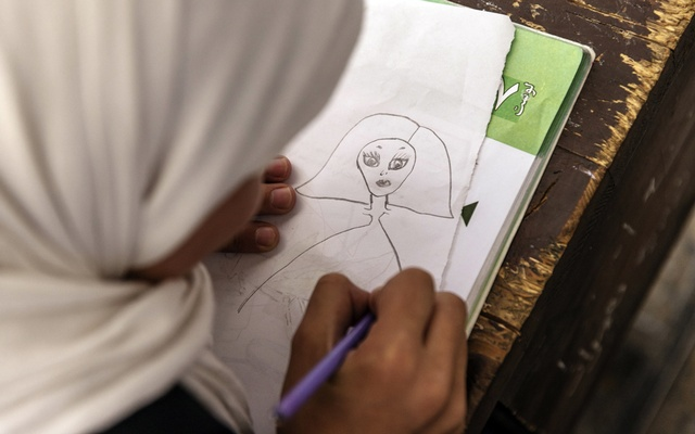 A student draws during an art lesson at a school for girls in Kabul on Wednesday, Sept. 15, 2021. Afghanistan's new government is likely to severely restrict education for girls and women despite the Taliban's claims that schooling will eventually resume. (Victor J. Blue/The New York Times)