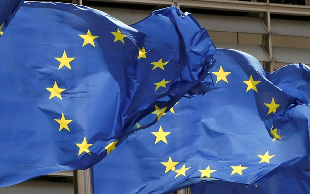 European Union flags flutter outside the EU Commission headquarters in Brussels, Belgium May 5, 2021. REUTERS