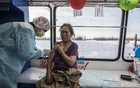 A woman receives a COIVD-19 vaccination at a mobile vaccination site in Yamal Peninsula in northwestern Siberia on Feb 27, 2021. The New York Times