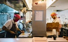Workers in the kitchen at Dirt Candy in Manhattan on Sept 14, 2021. Dirt Candy is one of many restaurants around the country that have created a new pay structure. (Lanna Apisukh/The New York Times)