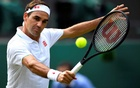 Switzerland's Roger Federer in action during his third round match at Wimbledon against Britain's Cameron Norrie, July 3, 2021 REUTERS/Toby Melville/File Photo