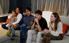 Canada's Liberal Prime Minister Justin Trudeau, accompanied by his wife Sophie Gregoire and his children Ella-Grace, Xavier and Hadrien watch the election coverage on a TV, in Montreal, Quebec, Canada, September 20, 2021. REUTERS/Carlos Osorio