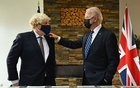 US President Joe Biden speaks with Britain's Prime Minister Boris Johnson, as they look at historical documents and artefacts relating to the Atlantic Charter during their meeting, at Carbis Bay Hotel, Carbis Bay, Cornwall, Britain June 10, 2021. REUTERS