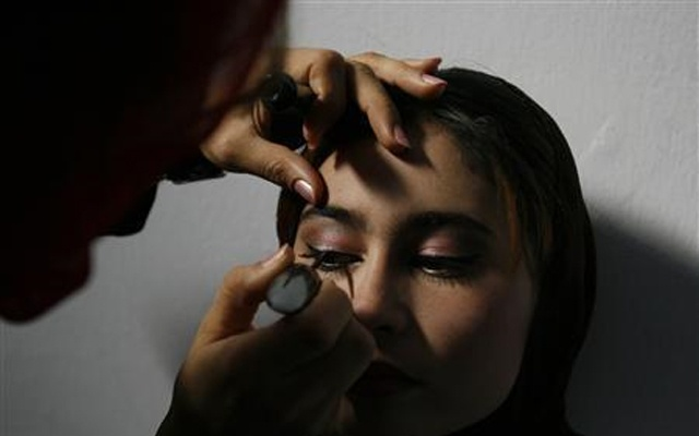An Afghan contestant gets her make-up done before a fashion competition initiated by Arzu, a private television channel in city of Mazar-I-Shariff north of Kabul. September 25, 2007. Reuters