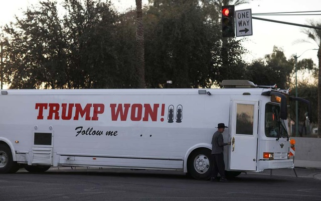 A supporter of US President Donald Trump arrives by bus ahead of a protest against the election of President-elect Joe Biden, in Phoenix, Arizona, US January 17, 2021. REUTERS/Caitlin O'Hara