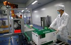 An employee works at a packaging line for chicken vaccine at Ringpu Biotech in Tianjin, China, September 8, 2021. REUTERS
