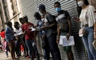 Migrants from Haiti line up to regularise their migratory situation outside of the Mexican Commission for Aid to Refugees (COMAR), in Mexico City, Mexico September 22, 2021. REUTERS/Edgard Garrido