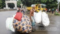 An elderly man carries bags full of abandoned plastic bottles collected from parts of Dhaka for sale, at Dhaka University. Photo: Asif Mahmud Ove