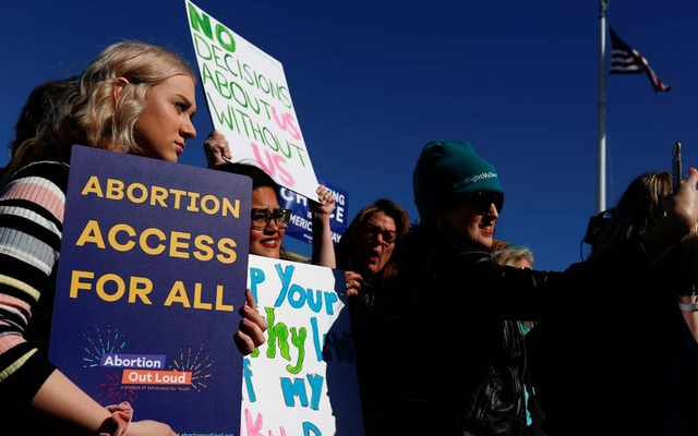 Pro-choice demonstrators hold up signs during a group chant outside of the US Supreme Court as justices hear a major abortion case on the legality of a Republican-backed Louisiana law that imposes restrictions on abortion doctors, on Capitol Hill in Washington, US, March 4, 2020. REUTERS/Tom Brenner